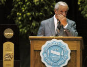 FILE - North Carolina basketball coach Roy Williams wipes away tears after giving a speech about his seniors during UNC's annual basketball awards ceremony at the Dean E. Smith Center in Chapel Hill, N.C., in this Tuesday, April 12, 2005, file photo. North Carolina announced Thursday, April 1, 2021, that Hall of Fame basketball coach Roy Williams is retiring after a 33-year career that includes three national championships. (AP Photo/Sara D. Davis, File)
