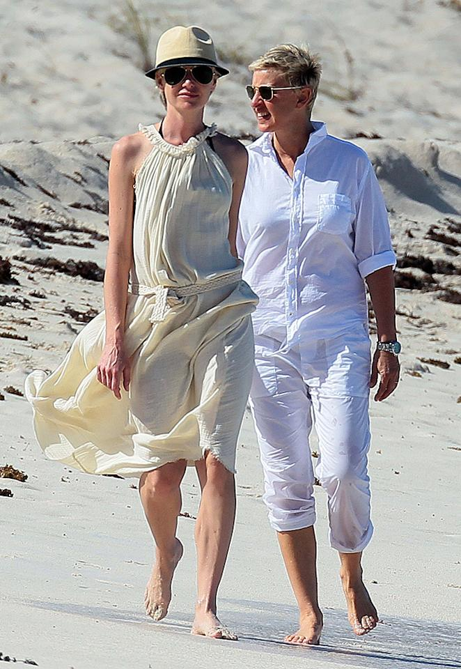 December 24, 2012: Ellen DeGeneres and Portia de Rossi walk hand in hand down St. Jean's Beach in St. Barth, French West Indies, after having lunch at the Eden Rock Restaurant.