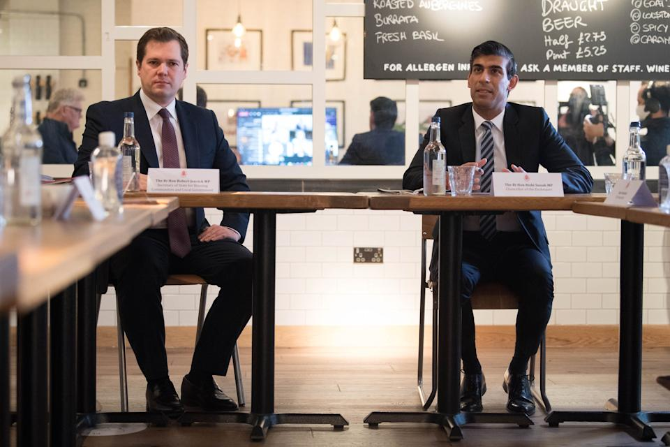 Britain's Chancellor of the Exchequer Rishi Sunak (R) hosts a roundtable meeting for business representatives flanked by Britain's Housing, Communities and Local Government Secretary Robert Jenrick (L) at a branch of the Franco Manca chain pizza restaurant in London on October 22, 2020. - The Chancellor announced on October 22 a new support package for businesses affected by Tier 2 coronavirus restrictions, the 'high' alert level which effects places like London and Birmingham, which include subsidies for pubs and restaurants. (Photo by Stefan Rousseau / POOL / AFP) (Photo by STEFAN ROUSSEAU/POOL/AFP via Getty Images)