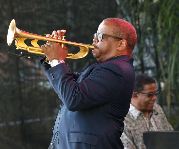 CORRECTS SPELLING OF FIRST NAME TO TERENCE - Terence Blanchard, foreground, and Herbie Hancock perform at a sunrise concert marking International Jazz Day in New Orleans, Monday, April 30, 2012. The performance, at Congo Square near the French Quarter, is one of two in the United States that day; the other is in the evening in New York. Thousands of people across the globe are expected to participate in International Jazz Day, including events in Belgium, France, Brazil, Algeria and Russia. (AP Photo/Gerald Herbert)