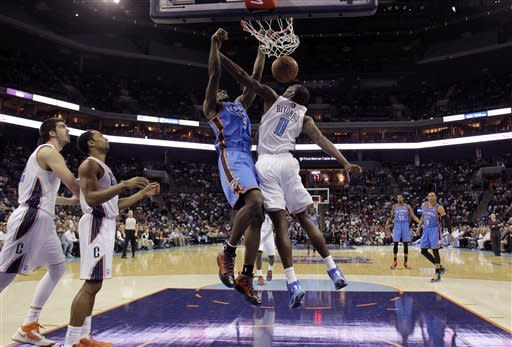Oklahoma City Thunder's Serge Ibaka (9) dunks agaisnt Charlotte Bobcats' Bismack Biyombo (0) during the first half of an NBA basketball game in Charlotte, N.C., Friday, March 8, 2013. (AP Photo/Bob Leverone)