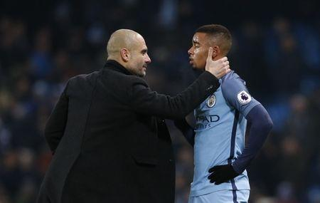 Manchester City manager Pep Guardiola with Manchester City's Gabriel Jesus after the match