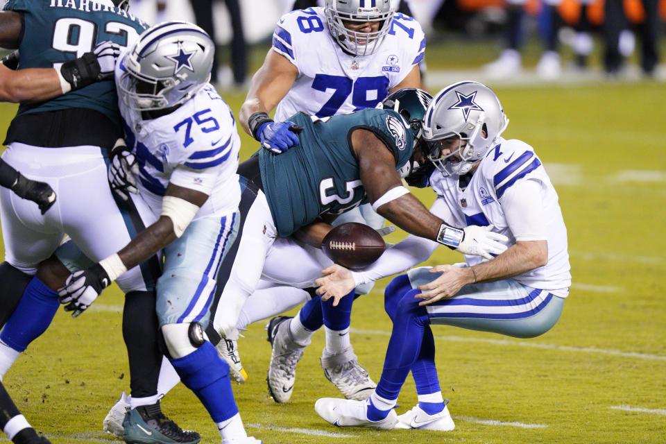 Dallas Cowboys' Ben DiNucci (7) fumbles as he is hit by Philadelphia Eagles' Brandon Graham (55). (AP Photo/Chris Szagola)