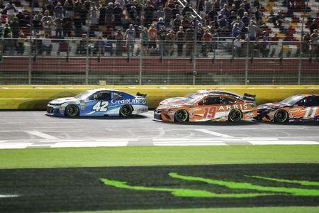 May 19, 2018; Concord, NC, USA; Monster Energy NASCAR Cup Series driver Kyle Larson (42) and driver Daniel Suarez (19) battle in the final segment for the lead during the NASCAR Cup Series All-Star Open at Charlotte Motor Speedway. Kevin Harvick won the All Star Open. Mandatory Credit: Jim Dedmon-USA TODAY Sports