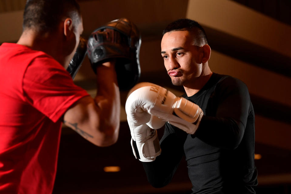 Featherweight champion Max Holloway worked out for the public on Wednesday at the MGM Grand in Las Vegas, hours before being pulled from his UFC 226 fight with Brian Ortega because of concussion-like symptoms. (Getty Images)