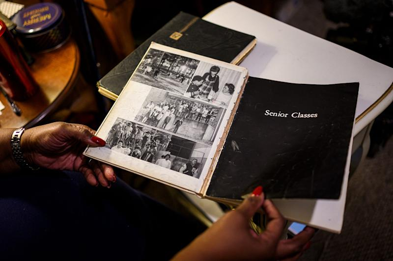 Barbara Franklin looks through a Beck High School yearbook. An abbreviated version of the yearbook was printed in limited quantities for the senior class at Beck, who moved to different schools during the school year.