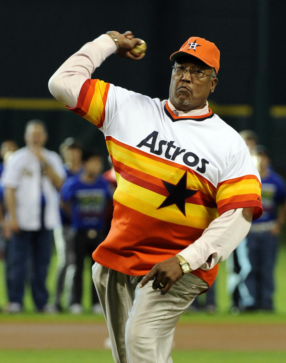 FILE - In this June 1, 2012, file photo, former Houston Astros pitcher J.R. Richard throws out the ceremonial first pitch before the Astros' baseball game against the Cincinnati Reds in Houston. Richard, a huge, flame-throwing right-hander who spent 10 years with the Astros before his career was cut short by a stroke, has died, the team announced, Thursday, Aug. 5, 2021. He was 71. (AP Photo/Pat Sullivan, File)