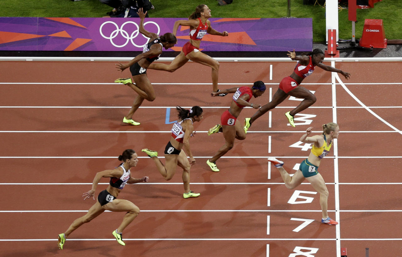 Australia's Sally Pearson crosses the finish line for a gold medal win in the women's 100-meter hurdles final during the athletics in the Olympic Stadium at the 2012 Summer Olympics, London, Tuesday, Aug. 7, 2012.(AP Photo/Mark Baker)