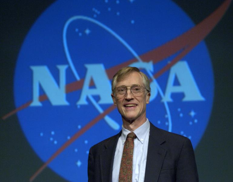 FILE - In this Oct. 3, 2006 file photo, Nobel Prize for Physics winner John Mather speaks at a news conference at NASA headquarters in Washington. Mather, the senior project scientist for NASA's James Webb Space Telescope, which is planned for launch into space in 2021, said the space-based instrument will be extremely effective at gathering infrared light and will help compensate for the advantage that Hawaii's Mauna Kea has over the backup site on La Palma, Spain. (AP Photo/Kevin Wolf, File)