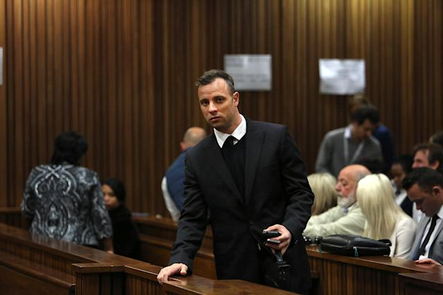 Oscar Pistorius enters the dock during the third day of his resentencing hearing for the 2013 murder of his girlfriend Reeva Steenkamp, in the North Gauteng High Court in Pretoria, South Africa June 15, 2016. REUTERS/Alon Skuy/Pool