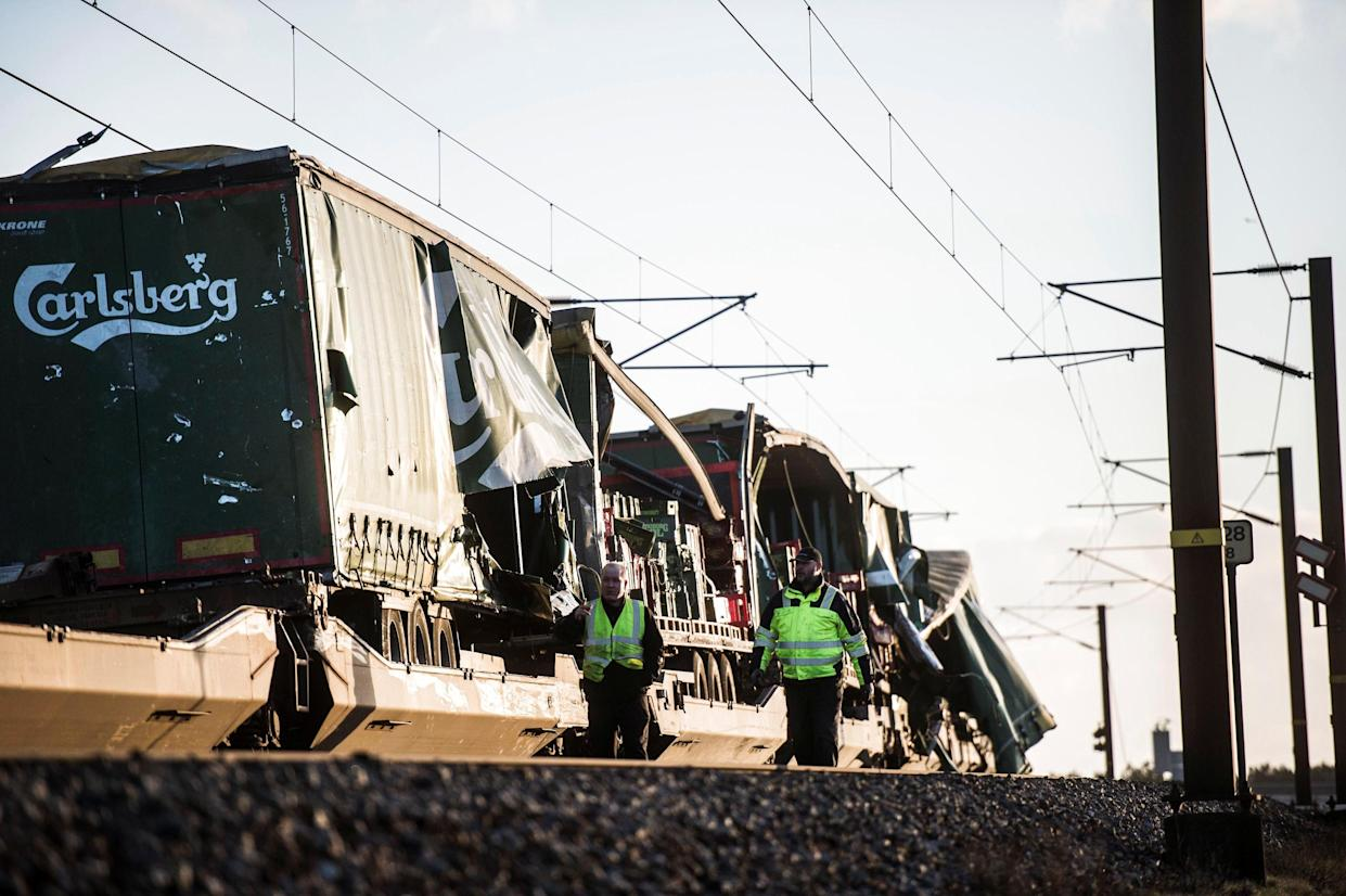 <em>Accident – it has not yet been confirmed how many people died after an accident involving a freight train and a passenger train on a bridge in Denmark (Picture: Reuters)</em>