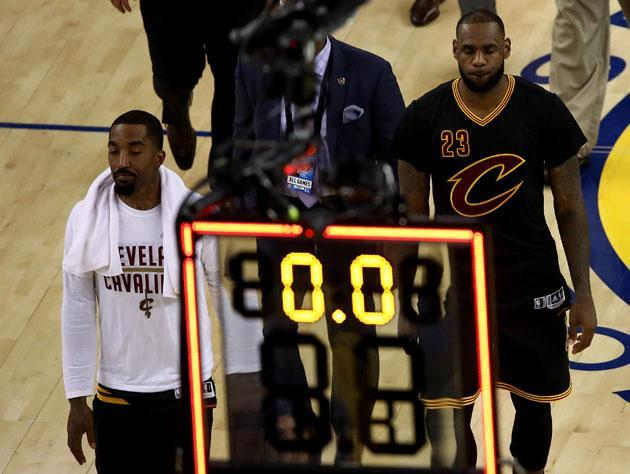 J.R. Smith and LeBron James walk off down 0-2. (Getty Images)