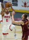 Houston Rockets' Eric Gordon (10) drives to the basket against Cleveland Cavaliers' Dylan Windler (9) in the second half of an NBA basketball game, Wednesday, Feb. 24, 2021, in Cleveland. The Cavaliers won 112-96. (AP Photo/Tony Dejak)