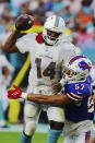 Buffalo Bills defensive end A.J. Epenesa (57) sacks Miami Dolphins quarterback Jacoby Brissett (14), during the first half of an NFL football game, Sunday, Sept. 19, 2021, in Miami Gardens, Fla. (AP Photo/Hans Deryk)