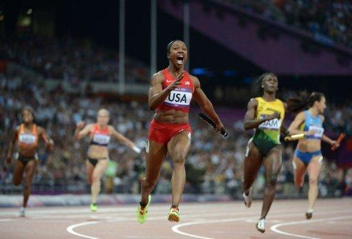 PHOTO OF THE DAY: USA's Carmelita Jeter takes her team to victory in the 4 x 100m relay final