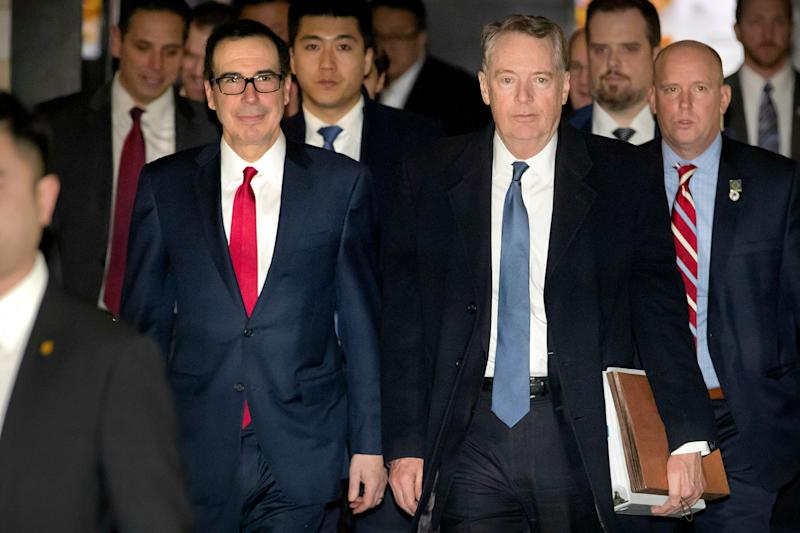 FILE - In this Feb. 15, 2019, file photo, U.S. Treasury Secretary Steven Mnuchin, left, and U.S. Trade Representative Robert Lighthizer walk together as they leave their hotel in Beijing. China says U.S. trade negotiators will arrive in Beijing late Thursday afternoon and start the new round talks with a working dinner. (AP Photo/Mark Schiefelbein, File)