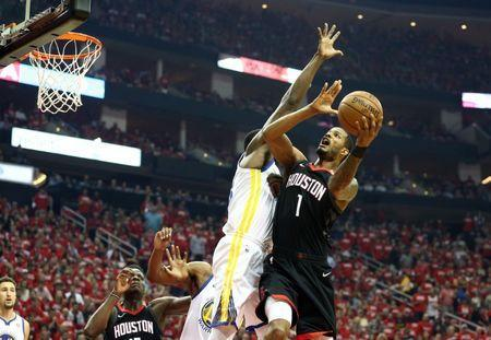 May 24, 2018; Houston, TX, USA; Houston Rockets forward Trevor Ariza (1) goes up for a shot against the Golden State Warriors during the first quarter in game five of the Western conference finals of the 2018 NBA Playoffs at Toyota Center. Mandatory Credit: Troy Taormina-USA TODAY Sports