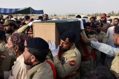 FILE PHOTO: Army soldiers carry the casket of Siraj Raisani, provincial assembly candidate of Baluchistan Awami Party (BAP), who was killed in Friday's suicide attack during an election campaign meeting, for the funeral in Quetta, Pakistan July 14, 2018. REUTERS/Naseer Ahmed