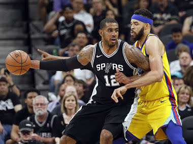Mar 19, 2018; San Antonio, TX, USA; San Antonio Spurs power forward LaMarcus Aldridge (12) posts up against Golden State Warriors center JaVale McGee (right) during the second half at AT&T Center. Mandatory Credit: Soobum Im-USA TODAY Sports - 10720956