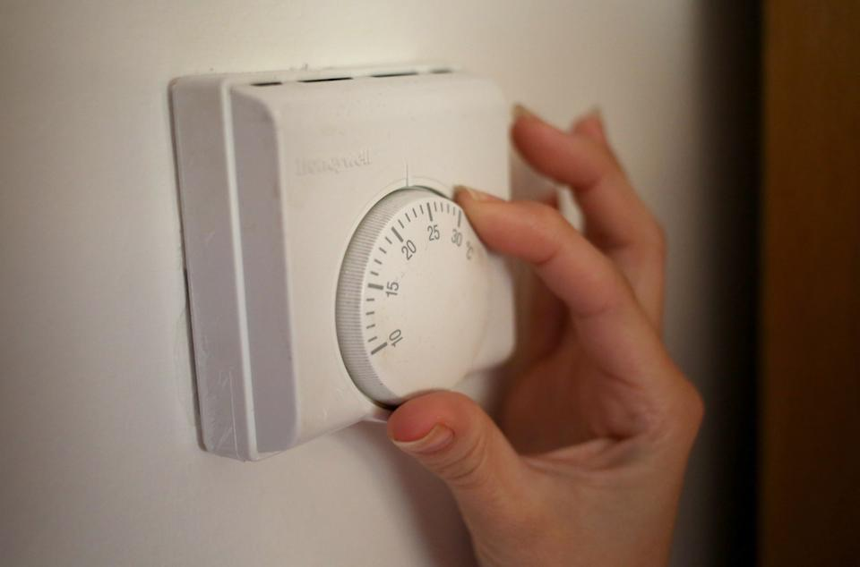 Undated file photo of a person using a central heating thermostat. Britons could see their energy bills rise by 30% next year, analysts have said. Research agency Cornwall Insight has predicted further volatile gas prices and the potential collapse of even more suppliers could push the energy price cap to about �1,660 in summer. Issue date: Thursday October 7, 2021.
