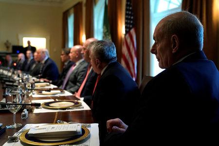 White House Chief of Staff John Kelly sits at the end of the table as U.S. President Donald Trump and Saudi Arabia's Crown Prince Mohammed bin Salman sit down to a working lunch with their delegations at the White House in Washington