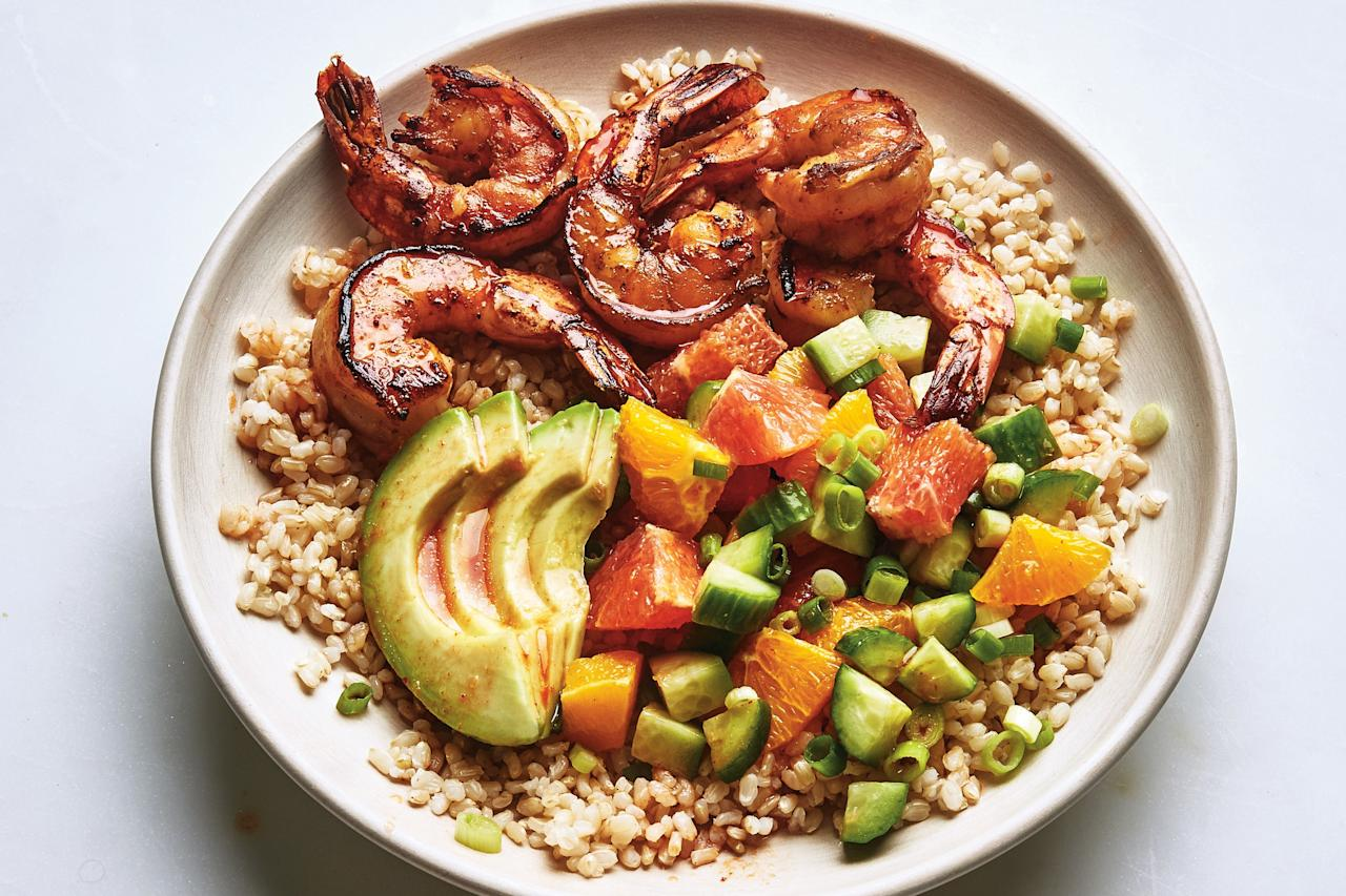 """This is one pretty dinner, and a great way to use avocados. Each bowl gets charred shrimp, rice, avocado, and a citrus-cucumber salad. <a href=""""https://www.epicurious.com/recipes/food/views/citrus-shrimp-rice-bowls?mbid=synd_yahoo_rss"""">See recipe.</a>"""