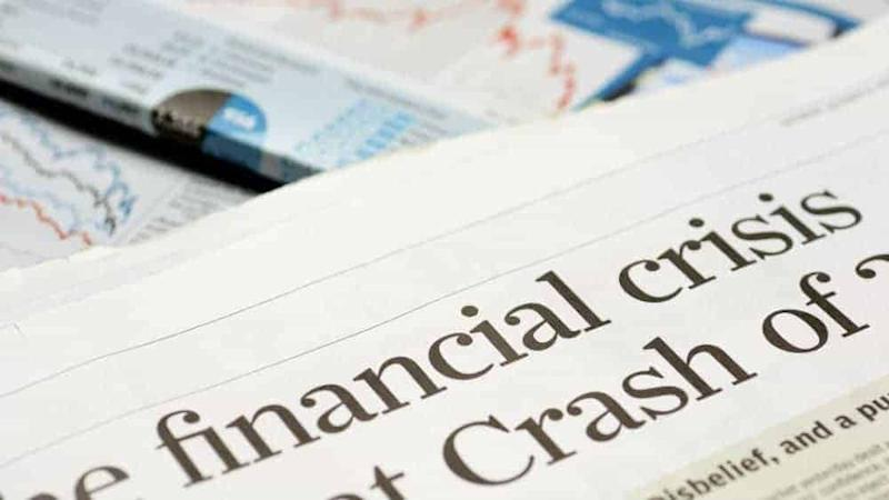 Close up of newspaper headline for financial crisis news