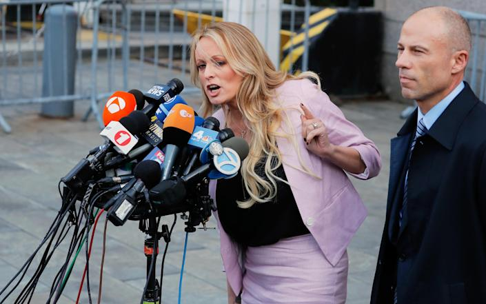 Stormy Daniels speaks to media along with lawyer Michael Avenatti outside federal court in the Manhattan on April 16. (Photo: Lucas Jackson/Reuters)