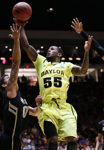 Baylor guard Pierre Jackson (55) shoots over Colorado forward Nate Tomlinson during the first half of an NCAA tournament third-round college basketball game on Saturday, March 17, 2012, in Albuquerque, N.M. (AP Photo/Matt York)