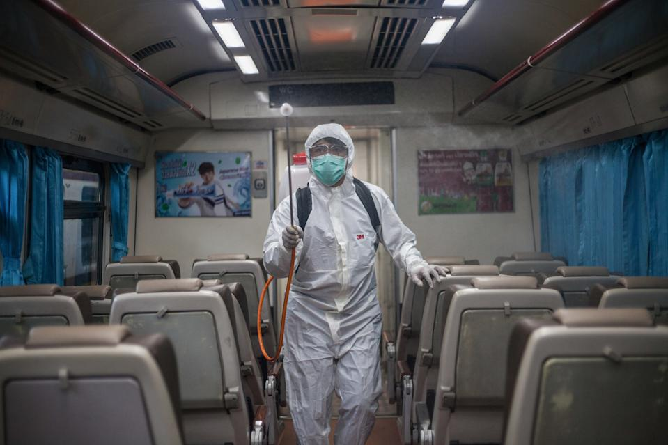 BANGKOK, THAILAND - 2020/03/04: A worker disinfects a train to avoid the spread of the COVID-19 at Hua Lamphong Railway Station. The total number of laboratory-confirmed COVID-19 cases reported in Thailand now stands at 43, of which 31 have recovered, 11 remain in hospital and one has died. (Photo by Adisorn Chabsungnoen/SOPA Images/LightRocket via Getty Images)