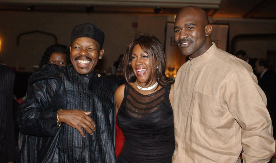 """FILE - In this Feb. 20, 2003 file photo, Lloyd Price, left, and Mary Wilson, of the Supremes, pose for a photograph with boxer Evander Holyfield during the reception of the 13th Annual Pioneer Awards presented by the Rhythm & Blues Foundation in New York. The New Orleans mainstay and Rock and Roll Hall of Famer has died. Price was known for such hits as """"Lawdy Miss Clawdy"""" and """"Stagger Lee."""" His wife Jackie said he died Monday, May 3, 2021 in New Rochelle, N.Y. (AP Photo/Frank Franklin II, File)"""