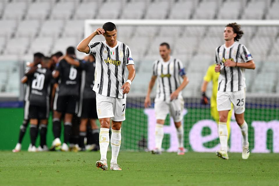 Juventus and Cristiano Ronaldo (foreground) are out of the UEFA Champions League after losing on away goals to French side Lyon in the round of 16. (Valerio Pennicino/Getty Images)