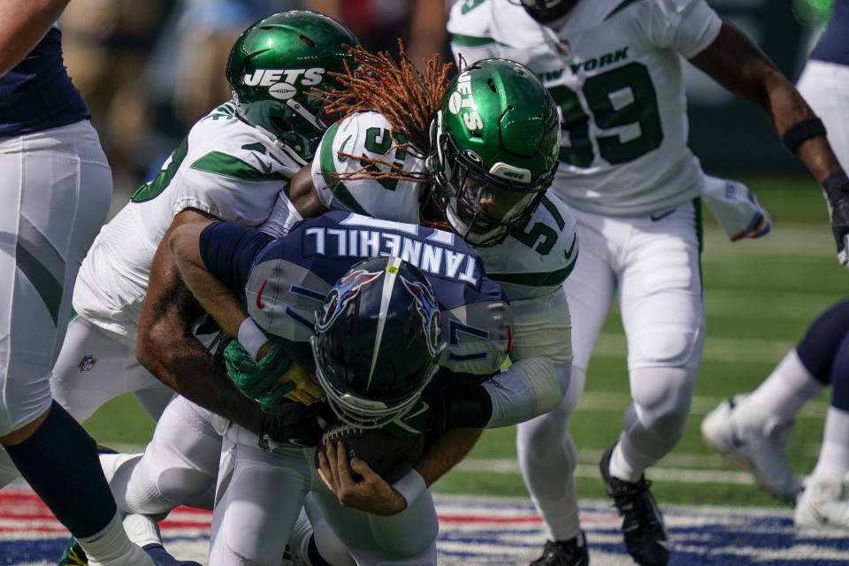 Tennessee Titans quarterback Ryan Tannehill (17) is sacked by New York Jets middle linebacker C.J. Mosley (57) during the first half of an NFL football game, Sunday, Oct. 3, 2021, in East Rutherford, N.J. (AP Photo/Seth Wenig)
