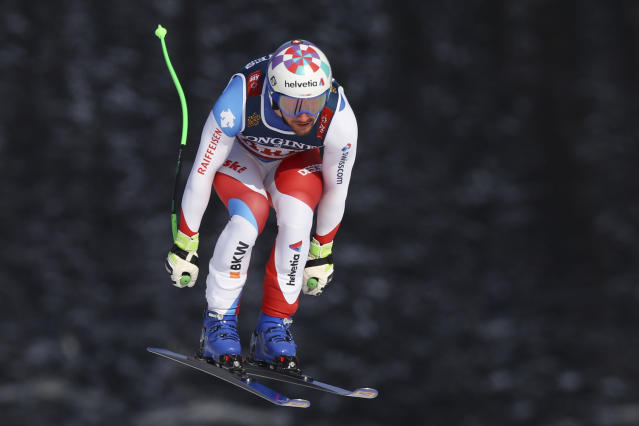 Switzerland's Luca Aerni speeds down the course during the downhill portion of the men's combined, at the alpine ski World Championships in Are, Sweden, Monday, Feb.11, 2019. (AP Photo/Marco Trovati)