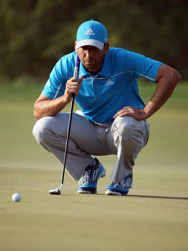 Sergio Garcia of Spain reads a line for a putt during the final round of the Commercial Bank Qatar Masters at the Doha Golf Club in Doha, Qatar, Saturday, Jan. 25, 2014. Garcia won the Qatar Masters on Saturday after he birdied the third extra hole to beat Finland's Mikko Ilonen in a playoff. (AP Photo/Osama Faisal)