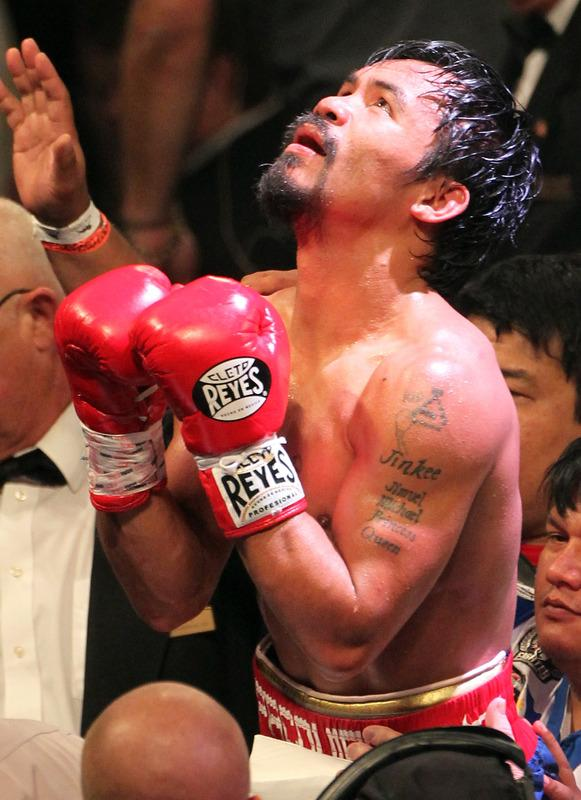 LAS VEGAS, NV - JUNE 09:  Manny Pacquiao reacts after his fight against Timothy Bradley at MGM Grand Garden Arena on June 9, 2012 in Las Vegas, Nevada.  (Photo by Jeff Bottari/Getty Images)
