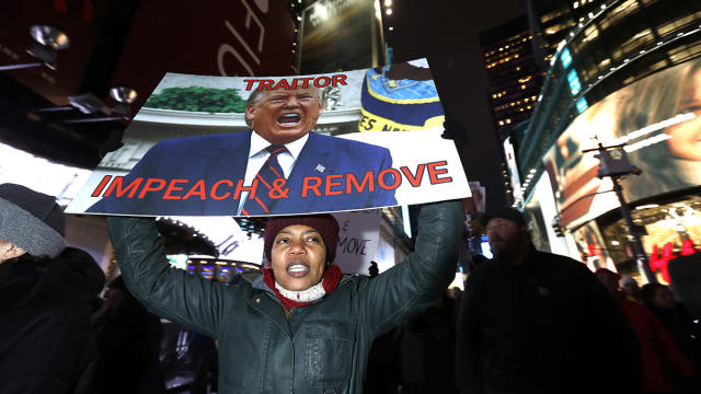 Protesters in New York's Times Square join national impeachment demonstrations on Tuesday to demand an end to Donald Trump's presidency. (Photo: John Lamparski/Getty Images for MoveOn.org)