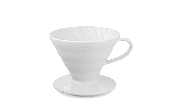 """<p><b>Hario V60 Ceramic Dripper</b><br /> Great coffee at home can definitely come from a machine, but most baristas prefer the primal pour-over method. With a dripper such as the<a href=""""http://www.mensjournal.com/food-drink/drinks/best-pour-over-coffee-maker-hario-v60-ceramic-coffee-dripper-20131018"""">Hario V60</a>, you can brew complex java in minutes. Erin McCarthy, from<a href=""""http://counterculturecoffee.com/"""">Counter Culture Coffee</a>in New York and winner of the<a href=""""http://www.worldbrewerscup.org/"""">2013 World Brewers Cup</a>, is a big fan. """"You have complete control over the brew method,"""" he says. McCarthy recommends grinding the beans immediately before you start. """"You get a lot more nuance if you do."""" Plus, there's a powerful, sensual aspect: """"Volatile aromatics come off the grounds when the water hits them, and the smell fills your kitchen – and that's awesome."""" So here's how to do it: Grind 5 tablespoons of coffee beans, and remove 16 ounces of water from a boil. Pour about 1 ounce over the grounds, and let them """"bloom"""" for 45 seconds, then slowly pour the remaining hot water in a circular motion over the grounds until you've used all of it, 3 to 4 minutes.<i>[$23;<a href=""""http://www.williams-sonoma.com/products/hario-v60-ceramic-coffee-dripper-white/"""">williams-sonoma.com</a>] <i> (Photo Courtesy of Hario)</i> </i><i> </i><b><a href=""""http://www.mensjournal.com/expert-advice/best-coffee-makers-for-any-brewing-method-20131018?utm_source=yahoofood&utm_medium=referral&utm_campaign=brewbettercoffee"""">Related: <i>The 11 Best Coffee Makers</i></a></b><br /></p>"""
