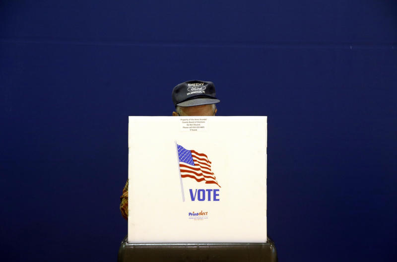 A voter fills out a ballot at a polling place at Lake Shore Elementary School, Tuesday, Nov. 6, 2018, in Pasadena, Maryland. (ASSOCIATED PRESS)