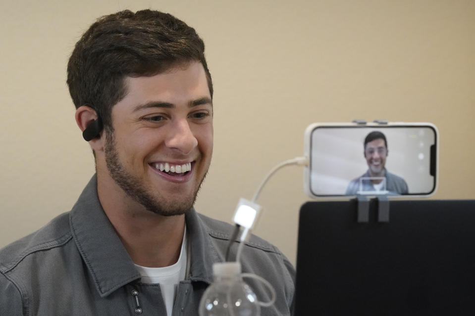 """Actor Jaren Lewison sets up for a tech check with a cell phone before giving virtual interviews to media Wednesday, June 23, 2021, in Dallas to promote his Netflix series """"Never Have I Ever."""" (AP Photo/LM Otero)"""