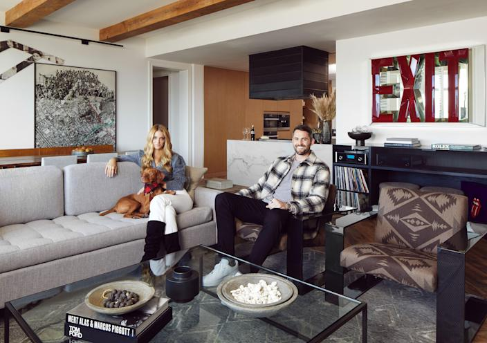 Love is joined by longtime girlfriend (and Swimsuit Illustrated cover model) Kate Bock and their beloved vizsla Vestry. A huge music fan, Love collects vintage vinyl and was gifted his McIntosh turntable stereo for his birthday. Doug Aitken's EXIT, a vibrant mirrored piece, makes one of the few bold color statements in the space.