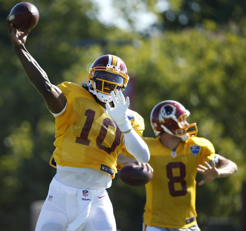 Things got tense for the Washington Redskins with quarterbacks Robert Griffin III, left, and Kirk Cousins. (AP)
