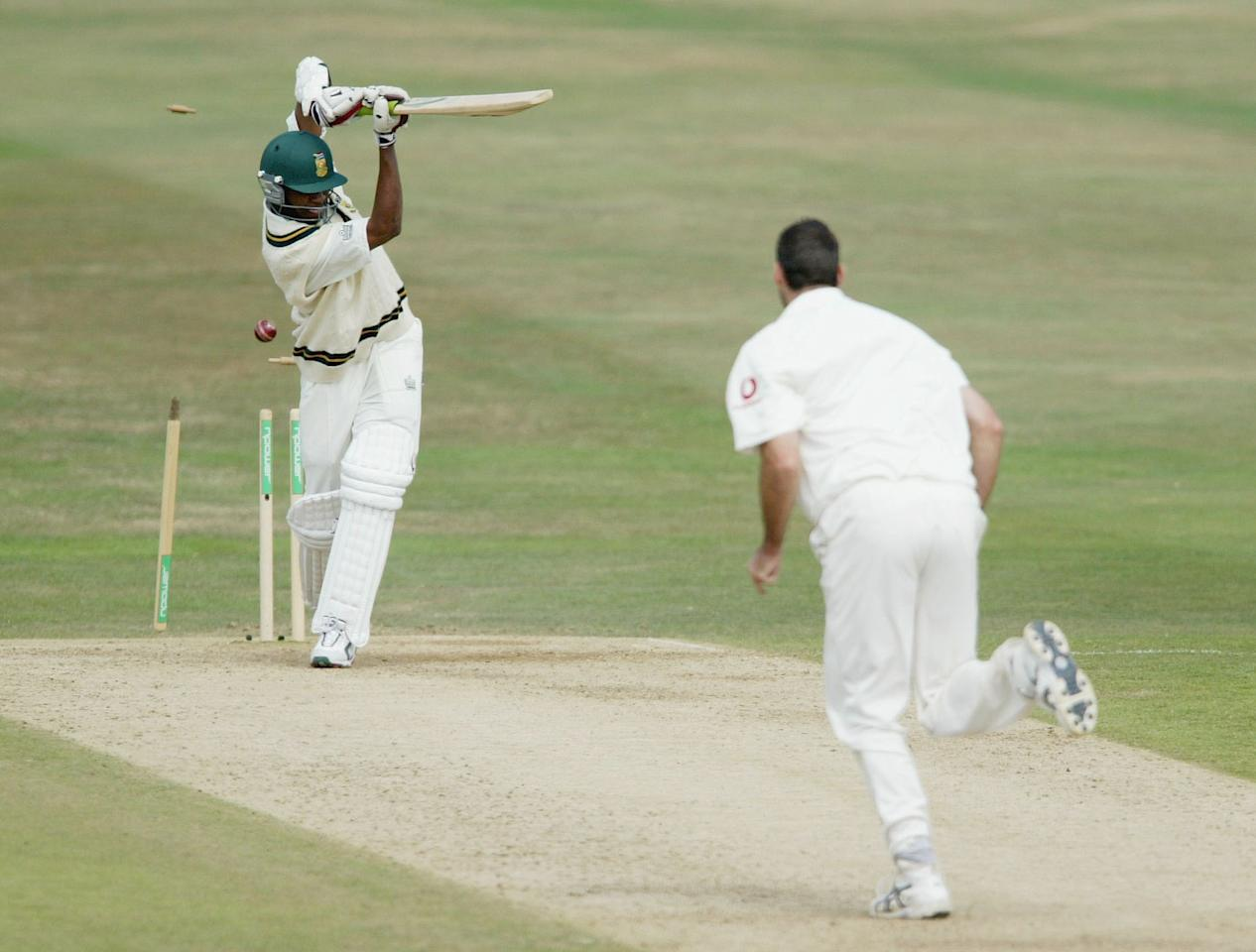 LEEDS, ENGLAND - AUGUST 24:  Martin Bicknell of England takes the wicket of Monde Zondeki of South Africa by bowling him out during the fourth day of the fourth npower test match between England and South Africa at Headingley Cricket Ground on August 24, 2003 in Leeds, England. (Photo by Laurence Griffiths/Getty Images)