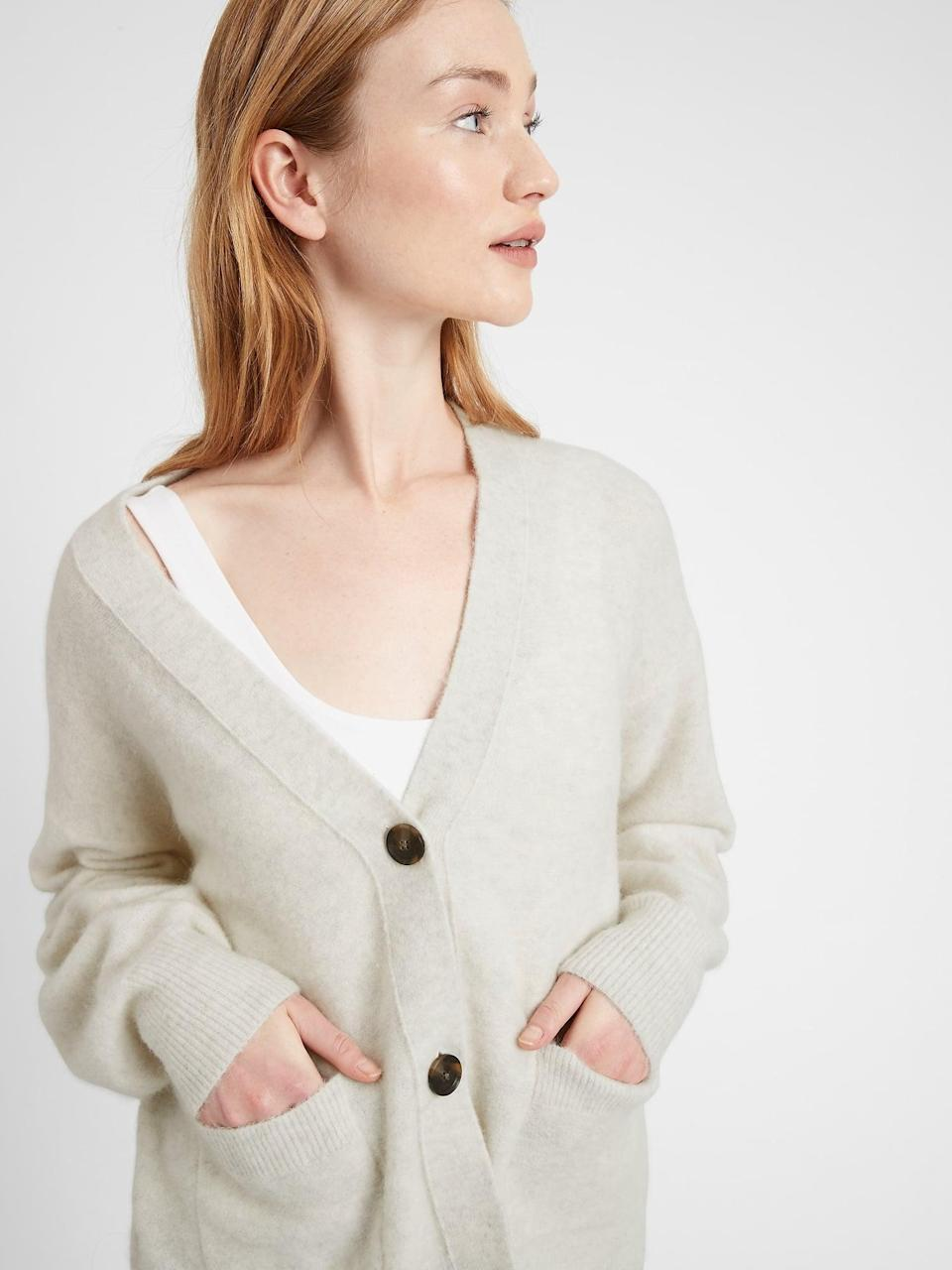 <p>This <span>Oversized Blouson-Sleeve Cardigan Sweater</span> ($88, originally $99) is a must-have for pulling together any cozy fall outfits.</p>