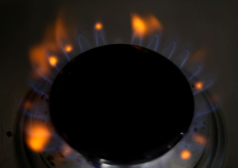 Flames come out of a domestic gas ring on a stove in Manchester