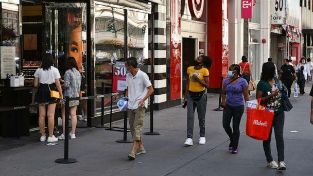 PHOTO: In this Sept. 1, 2020, file photo, people wear protective face masks while shopping along 34th Street in New York. (Erik Pendzich/REX via Shutterstock, FILE)
