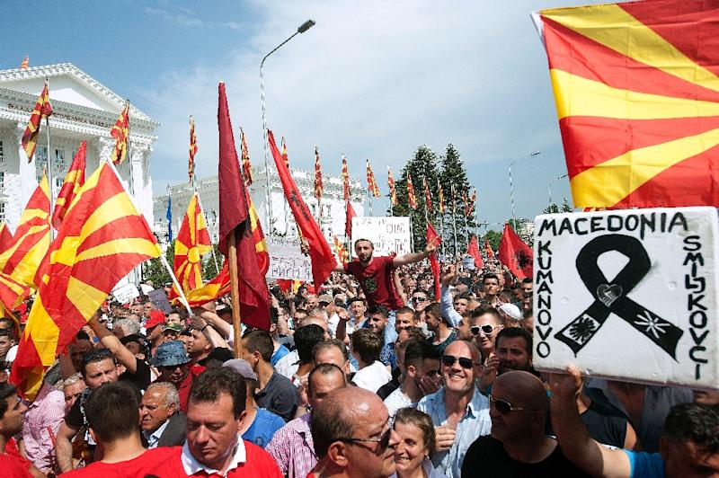 People wave Macedonian and Albanian flags during an opposition rally in Skopje on May 17, 2015 (AFP Photo/Robert Atanasovski)