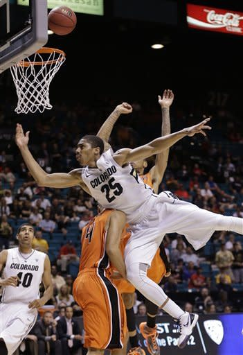 Colorado's Spencer Dinwiddie (25) is fouled as he shoots against Oregon State's Challe Barton in the second half during a Pac-12 tournament NCAA college basketball game, Wednesday, March 13, 2013, in Las Vegas. Colorado won 74-68. (AP Photo/Julie Jacobson)