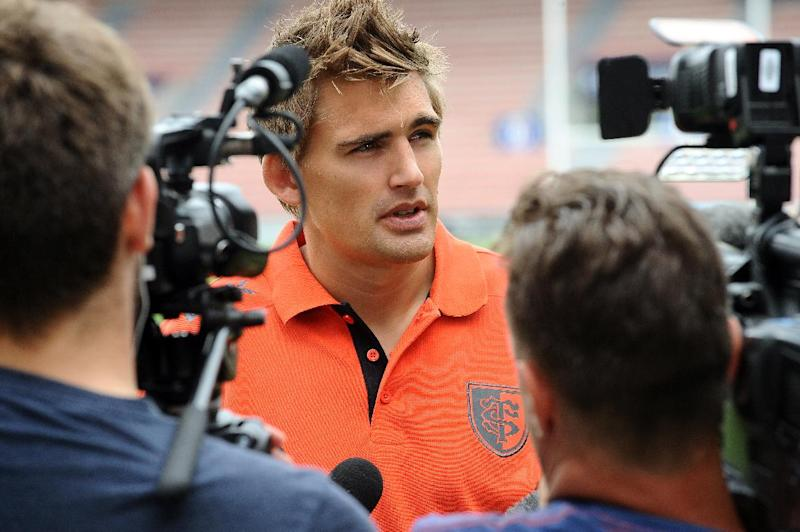 RC Toulouse English fly-half Toby Flood speaks to the press ahead of a training session at the Ernest Wallon stadium in Toulouse, southwestern France, on July 1, 2014