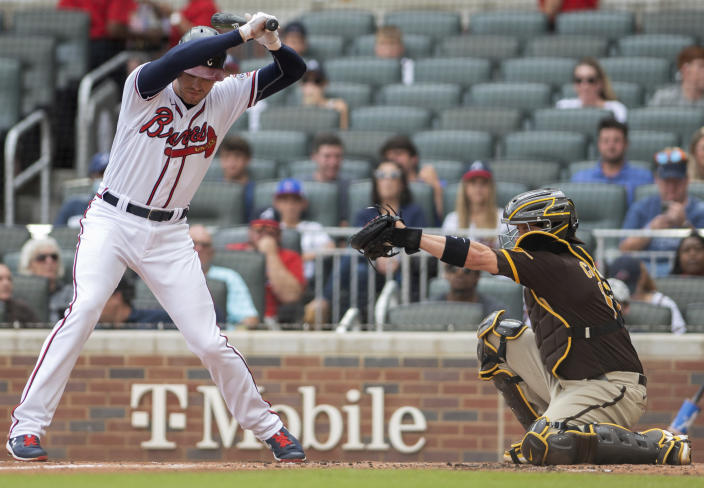 Atlanta Braves' Freddie Freeman avoids a pitch during the first inning of the second baseball game of a doubleheader against the San Diego Padres on Wednesday, July 21, 2021, in Atlanta. (AP Photo/Hakim Wright Sr.)